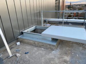 Installation of anchors, ladders, platforms and sliding hatch designed around a large-scale solar panel system.